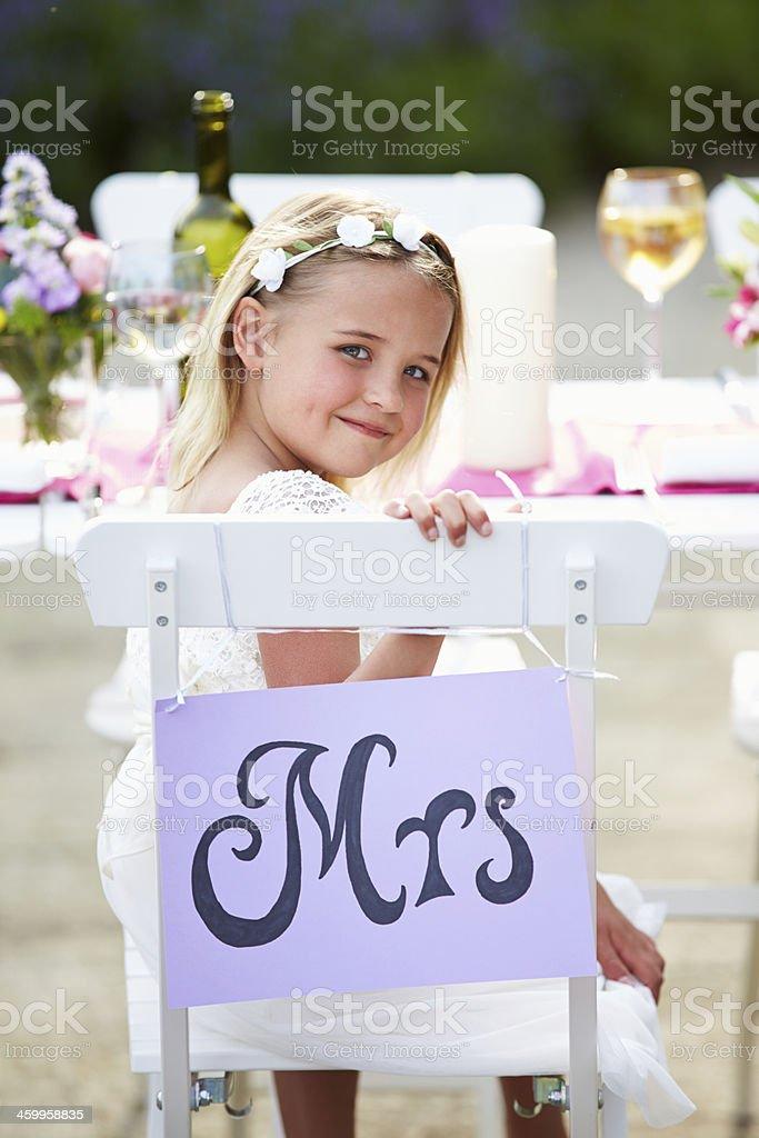 Bridesmaid Enjoying Meal At Wedding Reception stock photo
