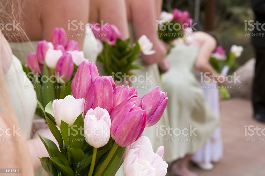 Bridesmaids Bouquet Detail and Flower Girl Whispering at Wedding Ceremony royalty-free stock photo
