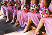 bridesmaids in pink dresses with sexy legs bouquets