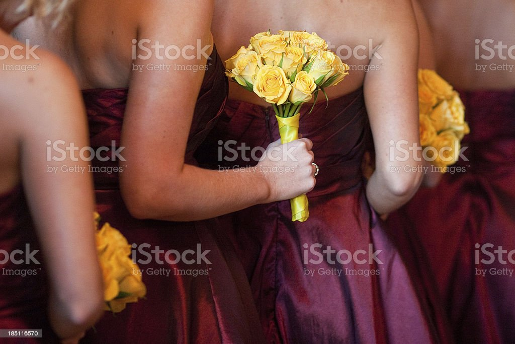 Bridesmaids with Yellow Bouquets Standing in Line Church stock photo