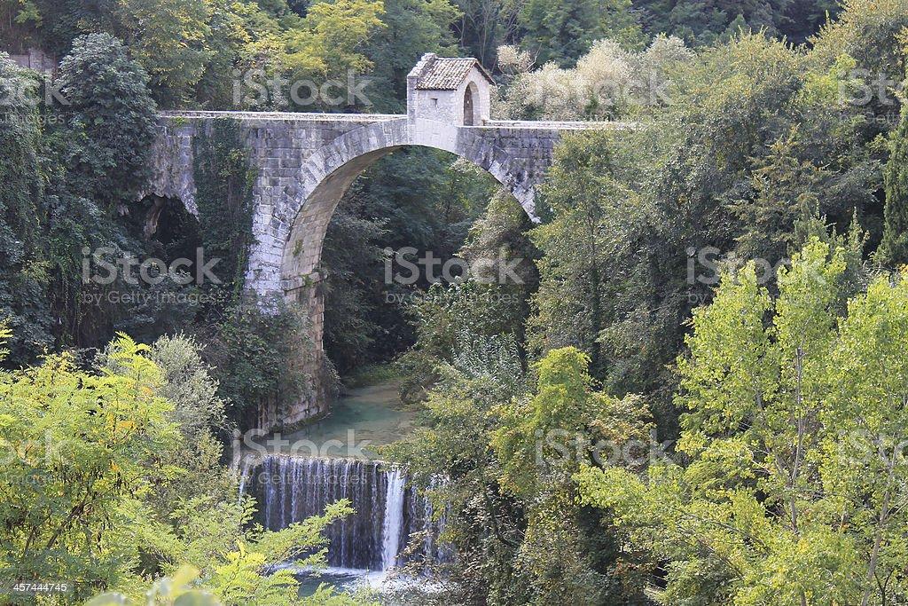 Bridge above waterfall royalty-free stock photo