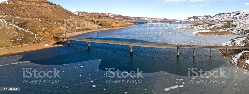 Bridge Along Frozen Lake Colorado Highway Over Gunnison River stock photo