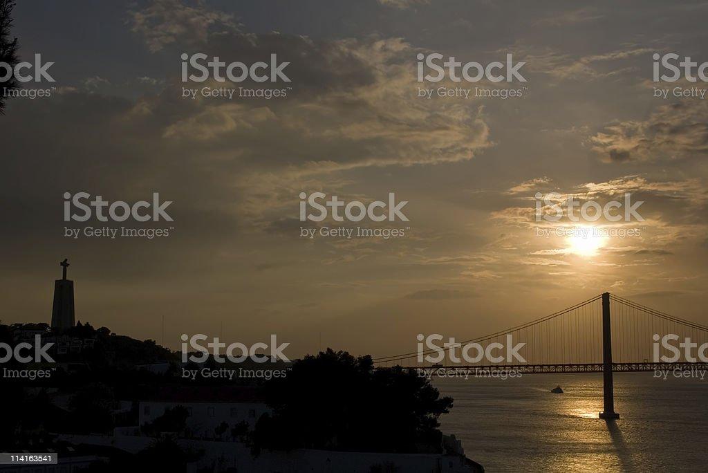 Bridge and Cristo Rei at sunset royalty-free stock photo