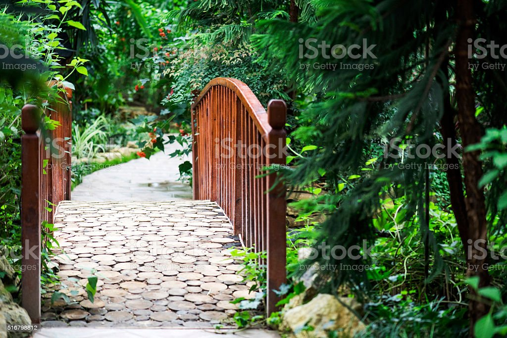 Bridge and footpath in garden stock photo