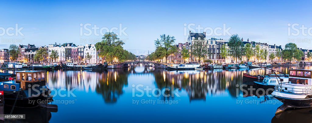 Bridge and Houses on Amstel River at Twilight Amsterdam Holland stock photo
