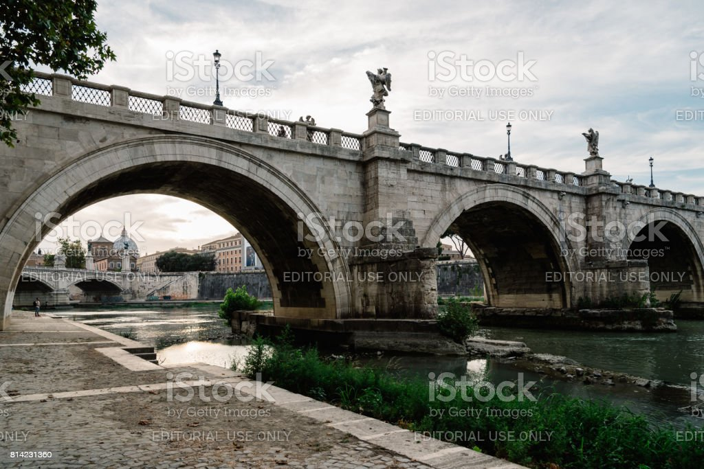 Bridge and Mausoleum Castel Sant Angelo at sunset stock photo