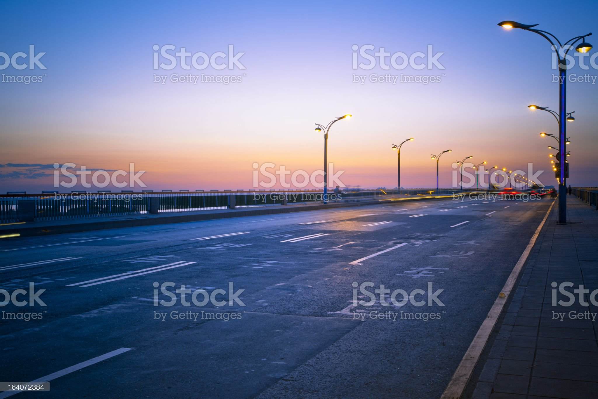 A bridge at night with lights on royalty-free stock photo