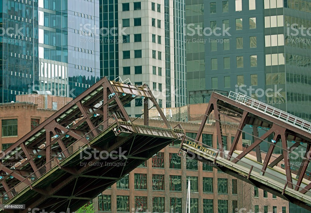Bridge being raised for sailboat in downtown Chicago IL stock photo