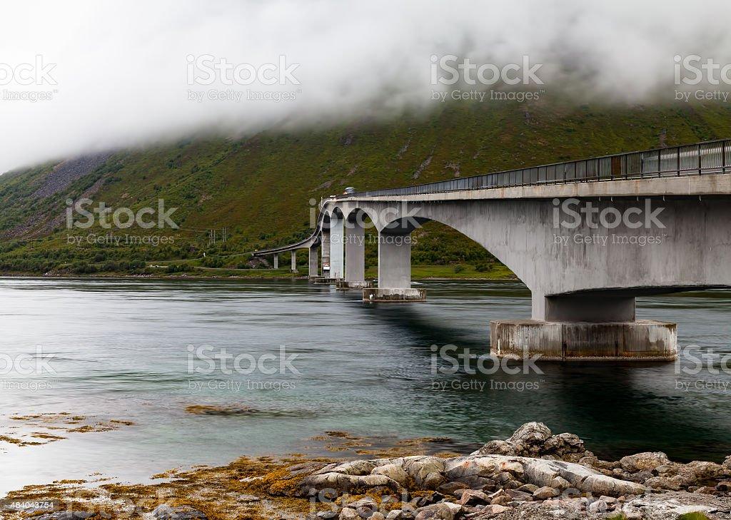 Bridge between islands in foggy weather stock photo