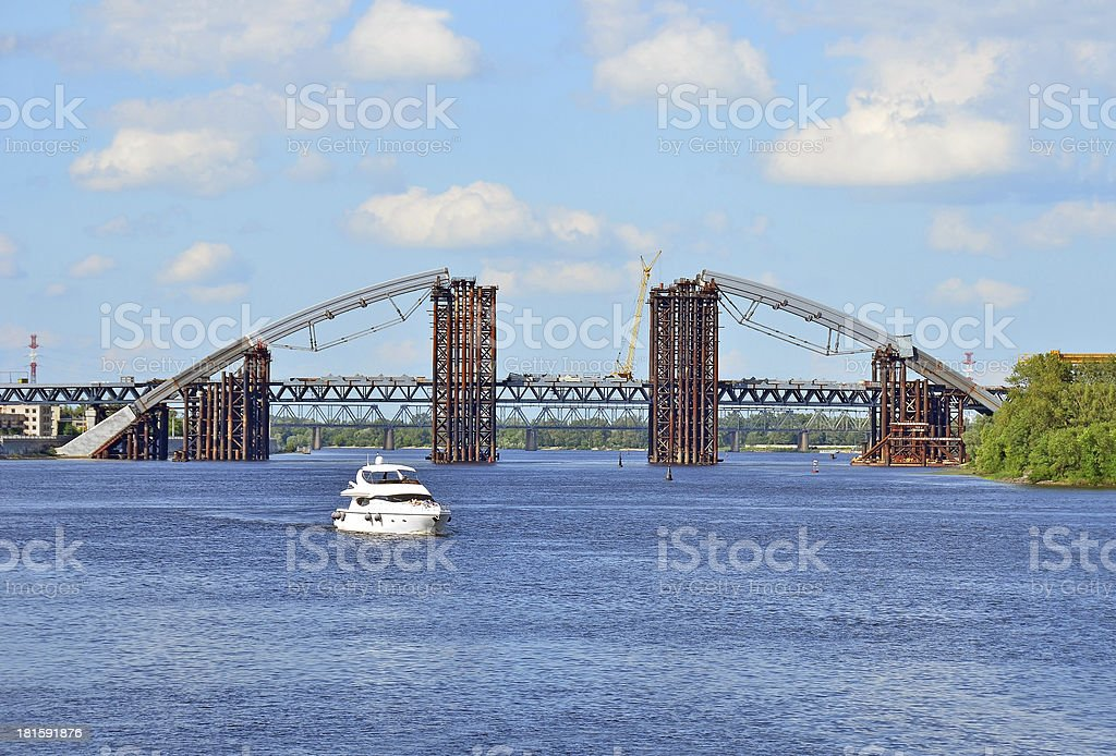 Bridge construction site and boat royalty-free stock photo