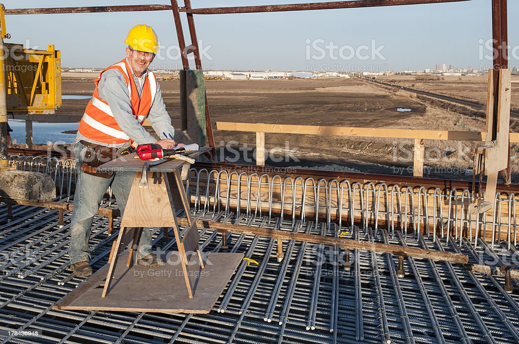 bridge construction worker at job site royalty-free stock photo