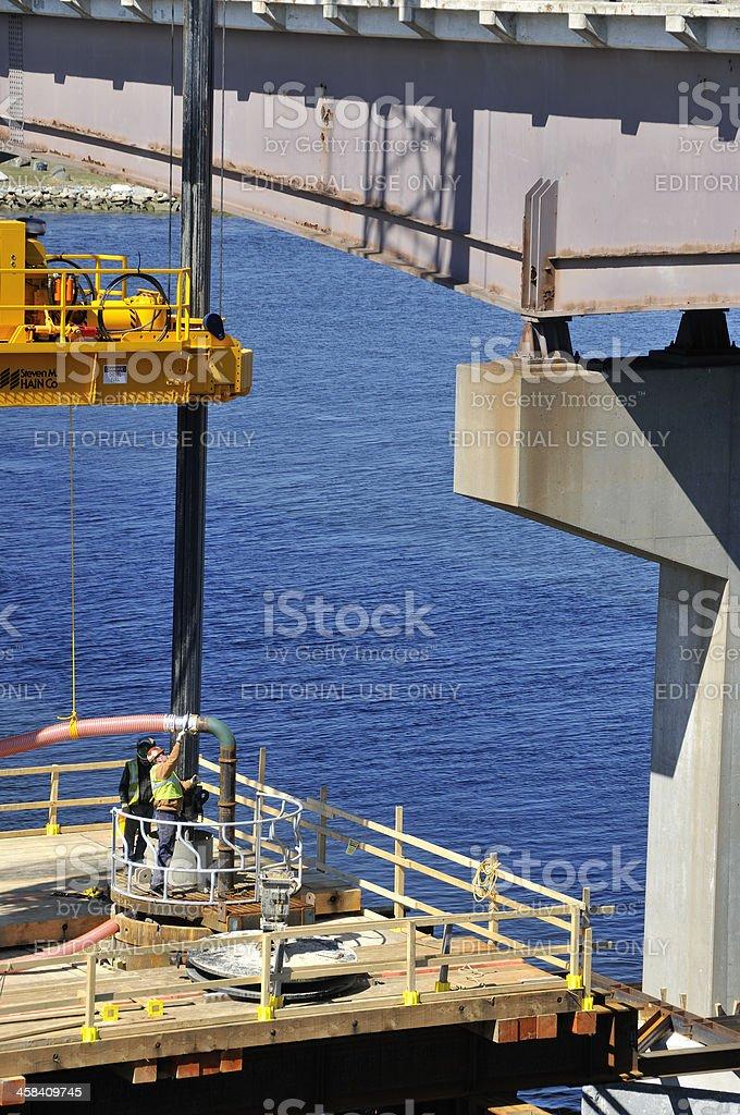 Bridge Construction Workers Driving Piles stock photo