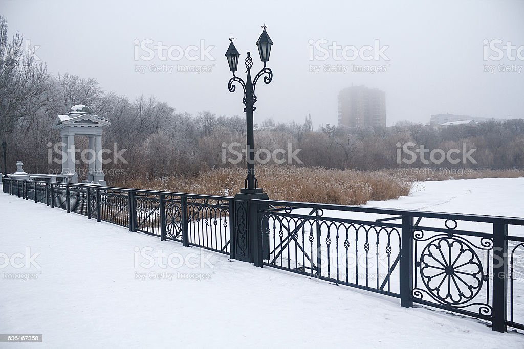 Bridge covered with snow and fog in the horizon. Donetsk stock photo