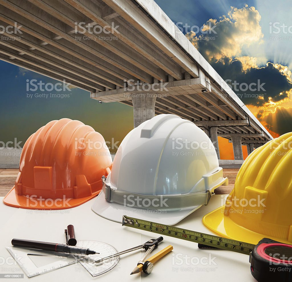 bridge crossing road junction and civil engineer working table stock photo