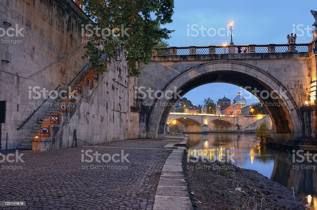 Bridge crossing the river Tiber royalty-free stock photo