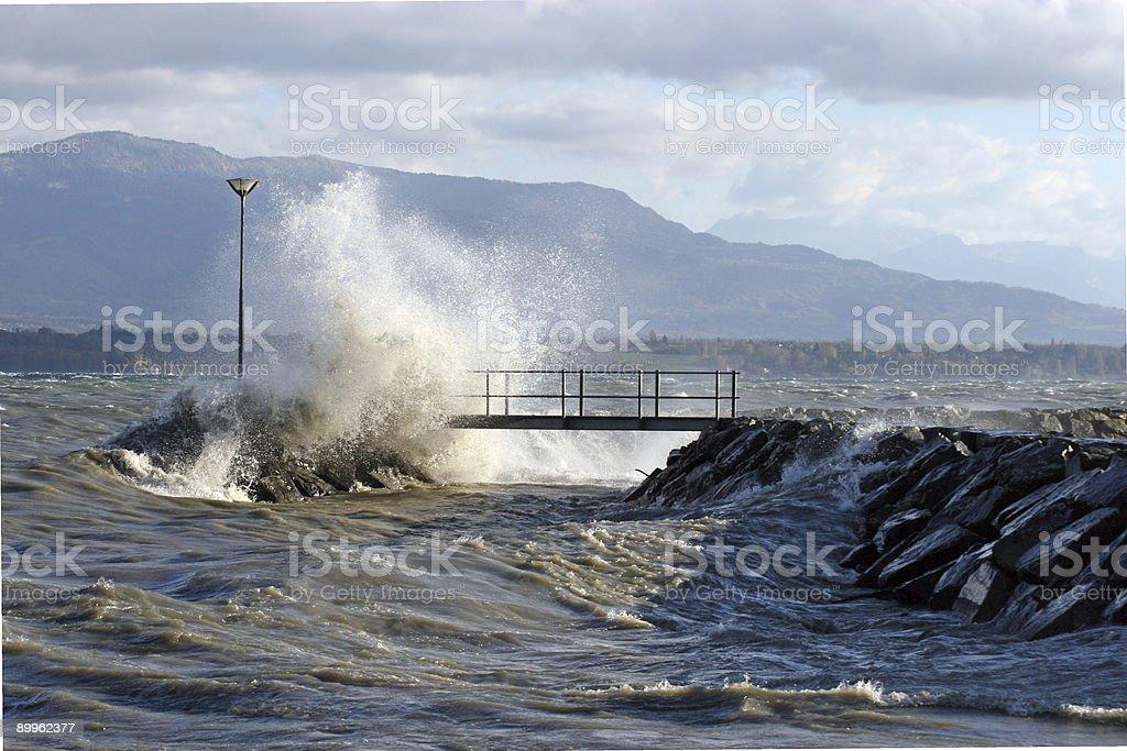 Bridge during storm on lake Geneva royalty-free stock photo