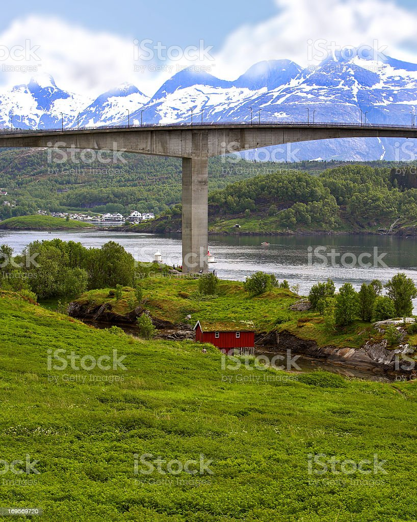 Bridge foregrounding mountains royalty-free stock photo
