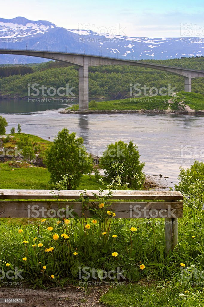 Bridge foregrounding mountains royalty-free stock photo