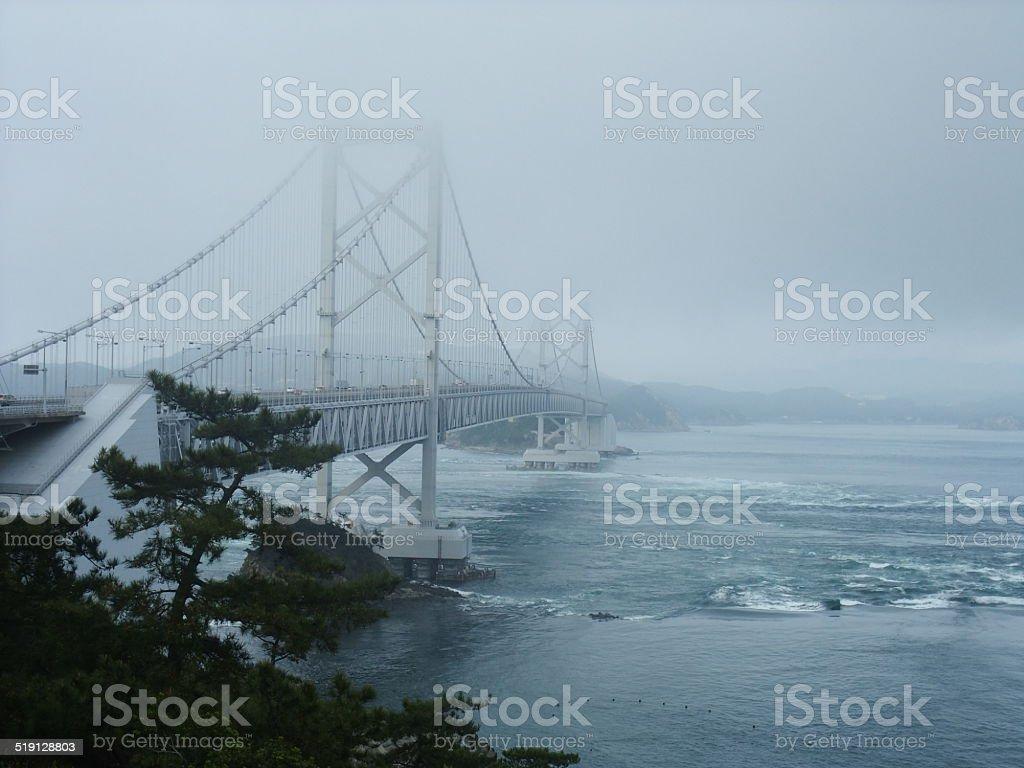 Bridge in the fog stock photo