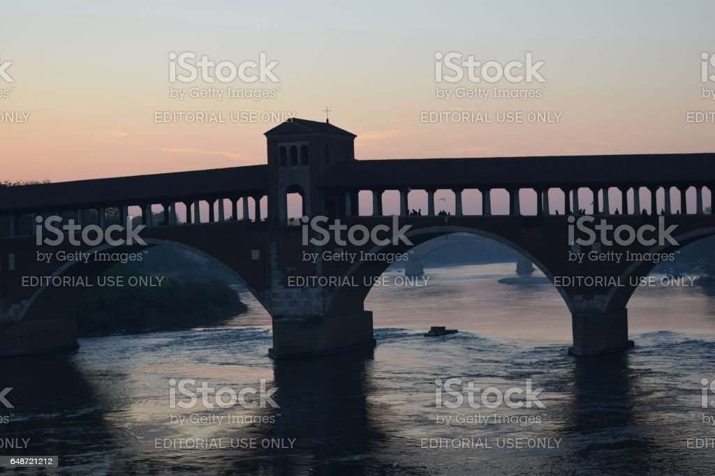 Bridge in the winter sun sets. 'Ponte Vecchio' in Pavia stock photo