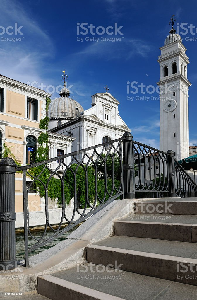 Bridge in Venice with Church and Temple Dome royalty-free stock photo
