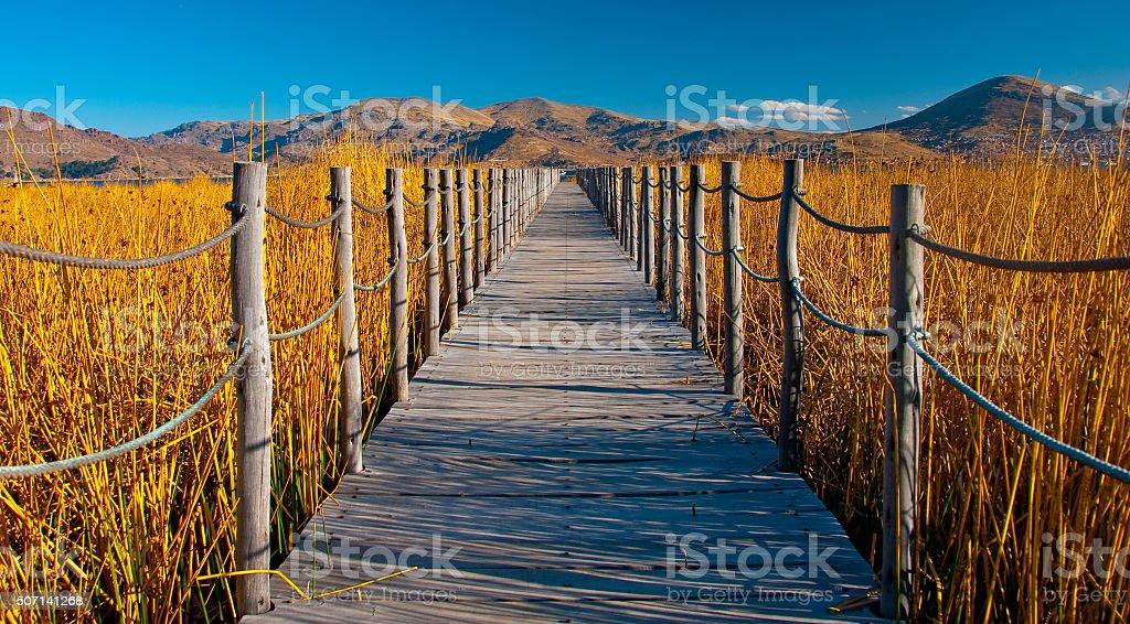 Bridge into Lake Titicaca stock photo