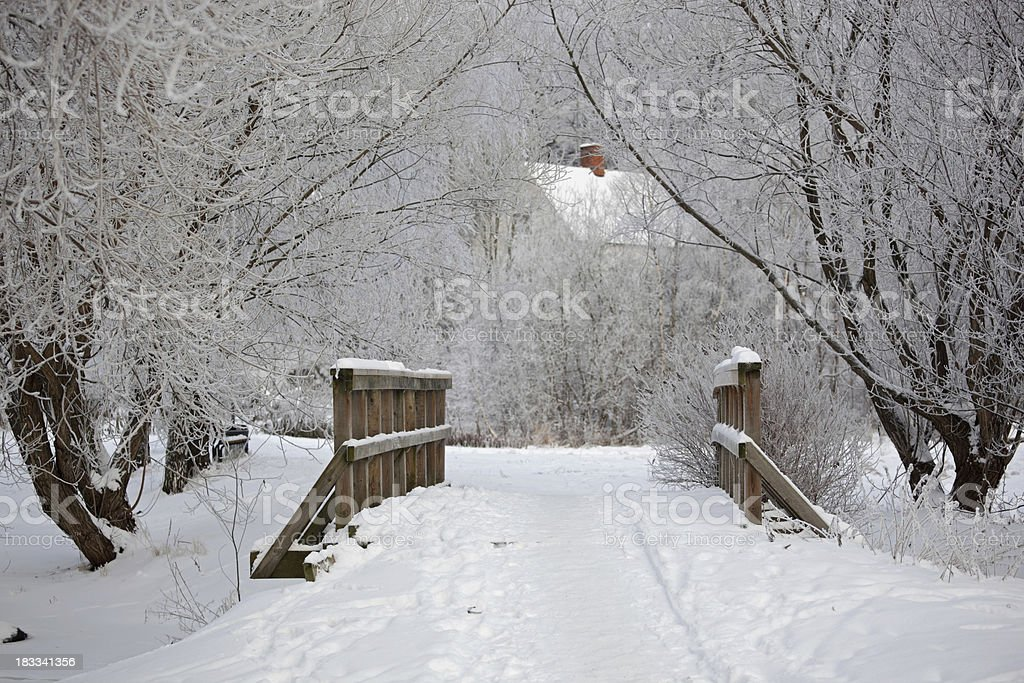 Bridge leading to house in Winter royalty-free stock photo
