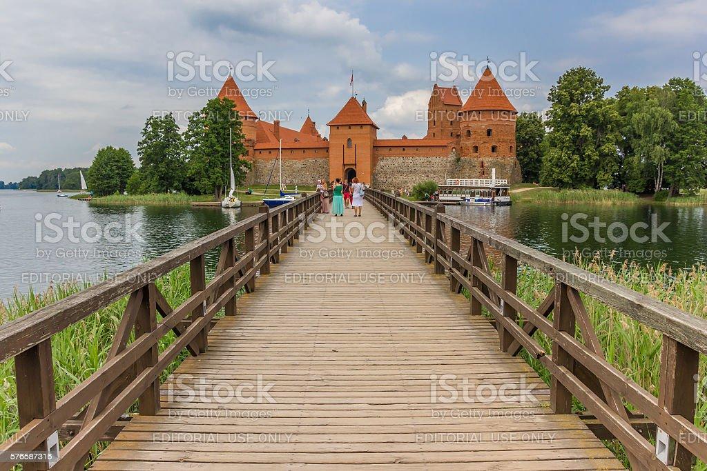 Bridge leading to the red brick castl in Trakai stock photo