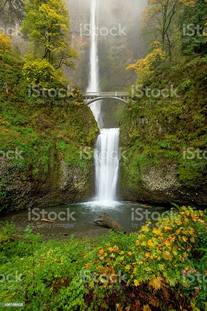 Bridge leads over a huge water fall in Oregon stock photo
