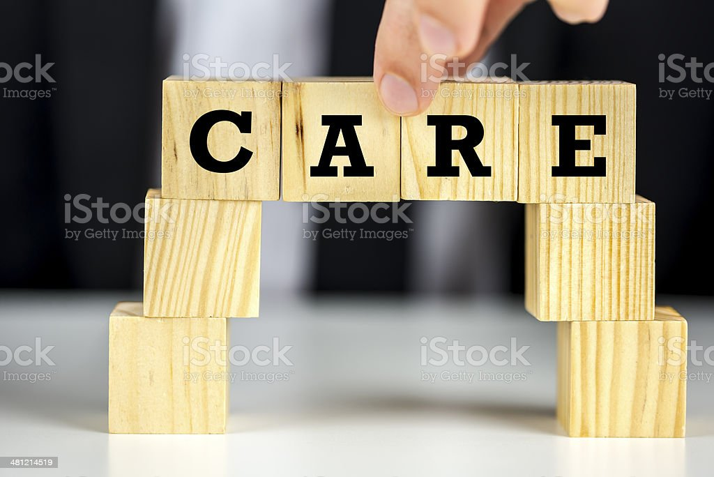 Bridge of cubes with word care written on them stock photo