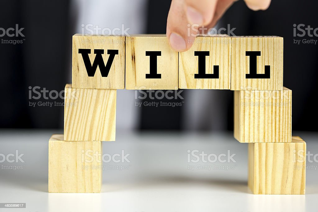 Bridge of cubes with word will written on them stock photo