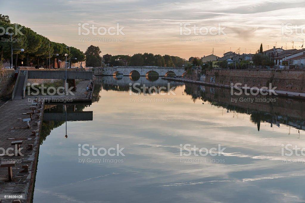 Bridge of Tiberius at sunset in Rimini, Italy. stock photo