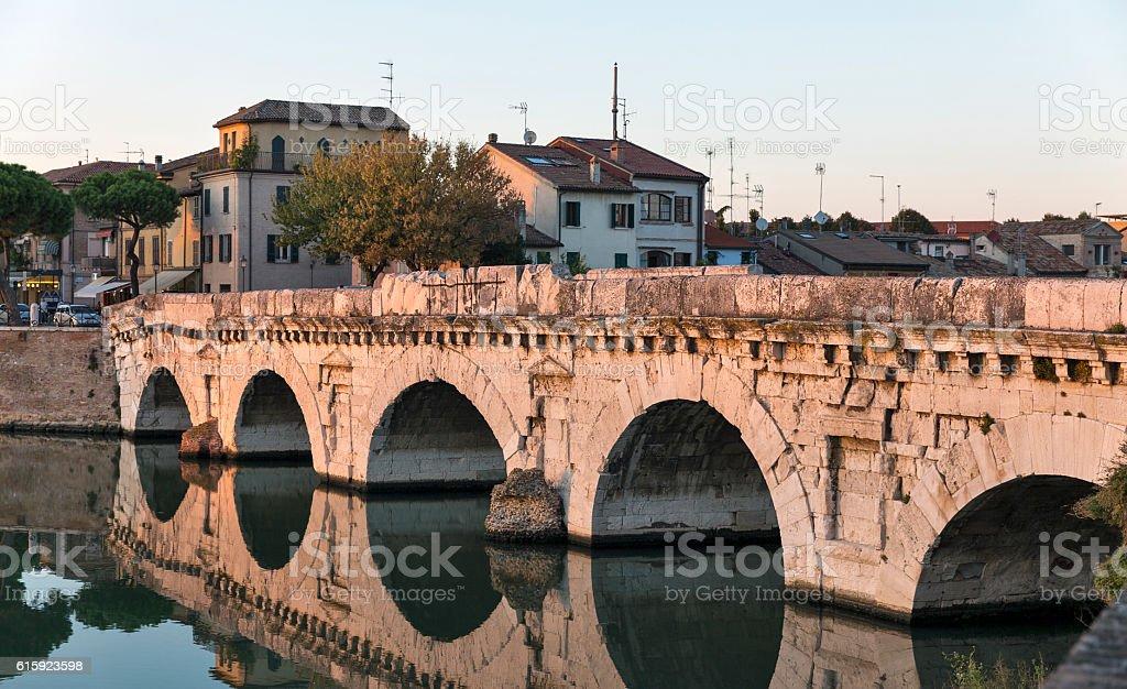 Bridge of Tiberius in Rimini, Italy. stock photo