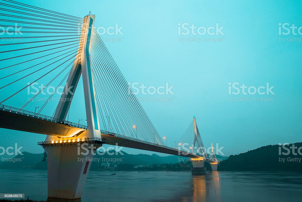 bridge on river at night stock photo