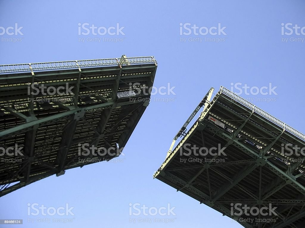 Bridge opening up to let boat through stock photo