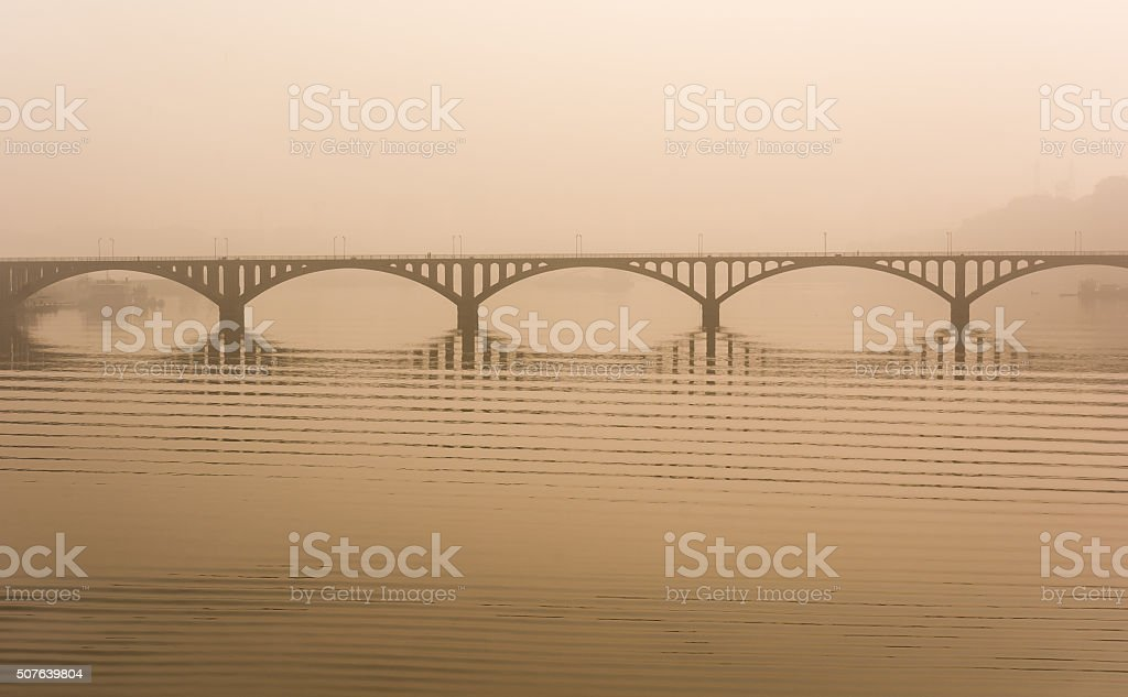 Bridge over a misty river stock photo