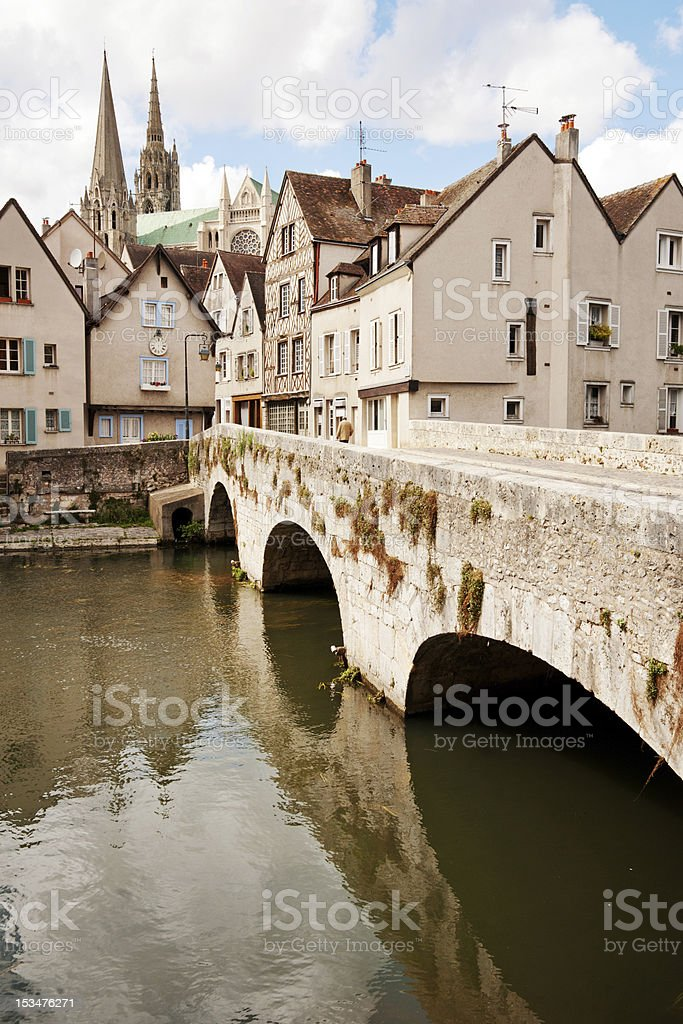 A bridge over a river flowing through the town of Chartres stock photo