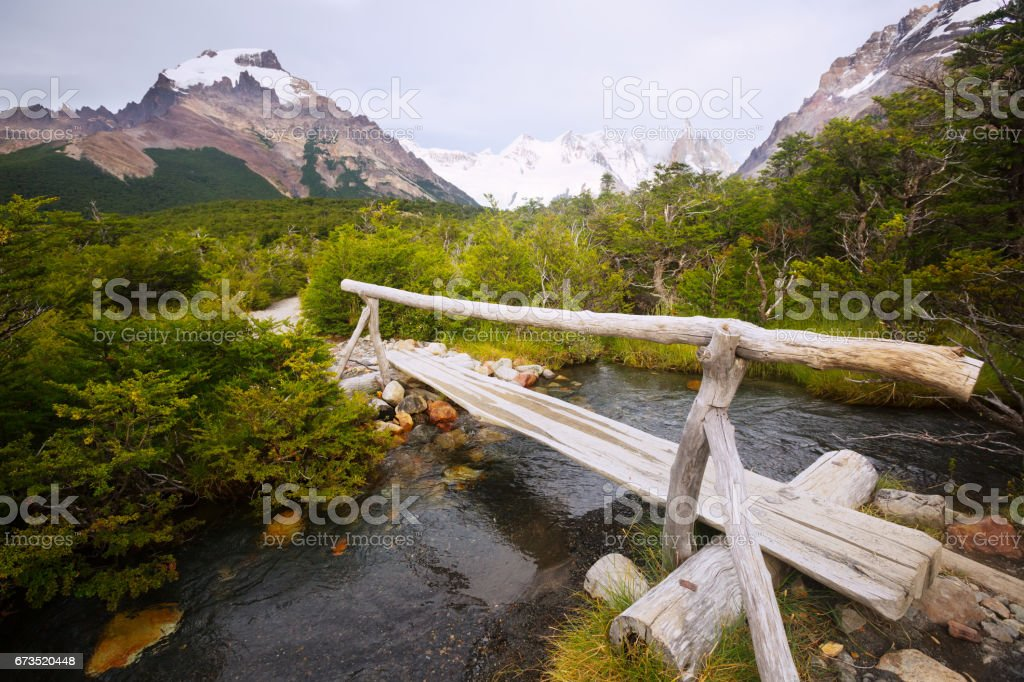Bridge over creek at foot of Andes mountains stock photo