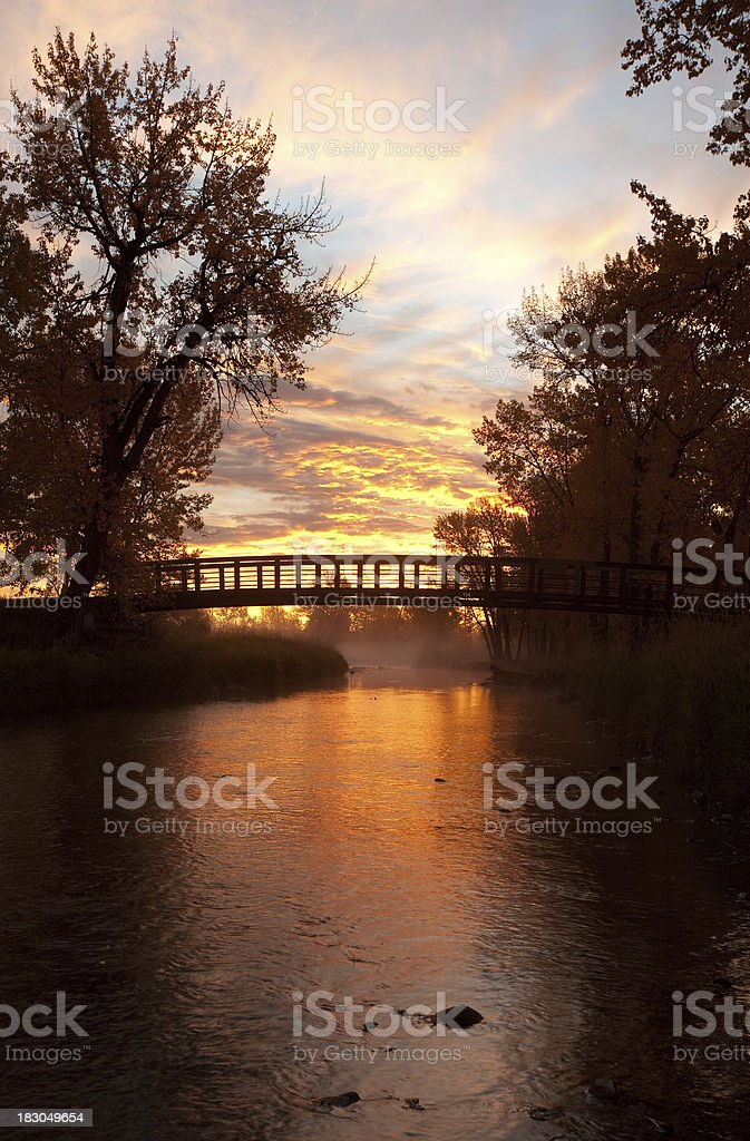 Bridge over Creek at Sunset royalty-free stock photo