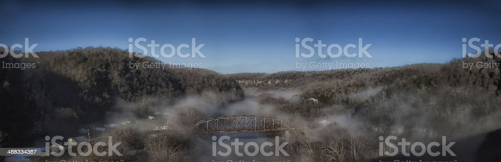 Bridge over Foggy Waters royalty-free stock photo