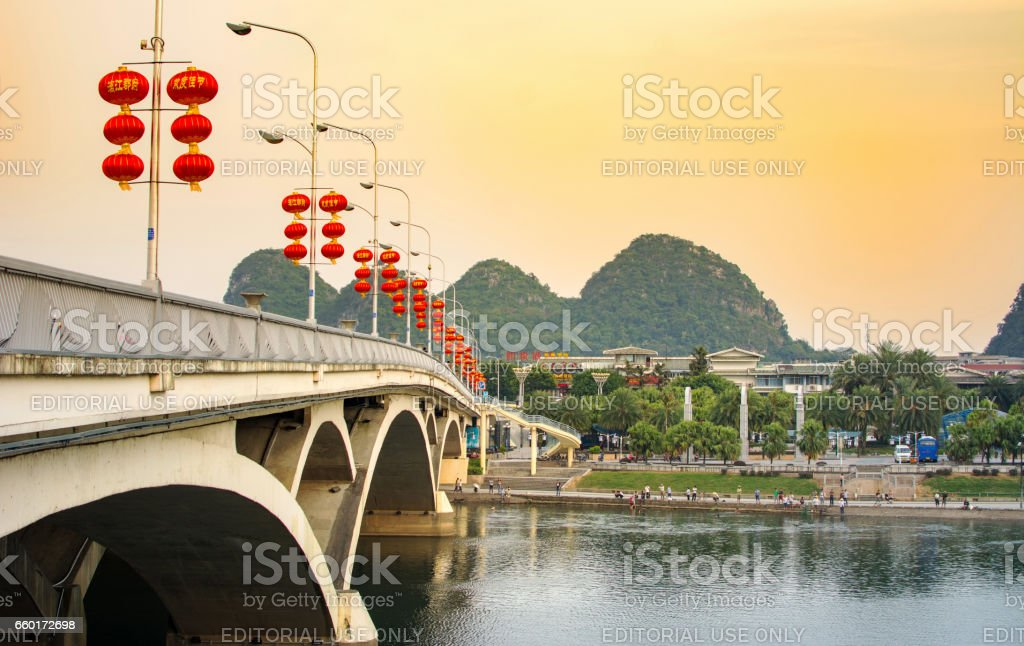 Bridge over Li river in the city central area decorated with Chinese lanterns stock photo