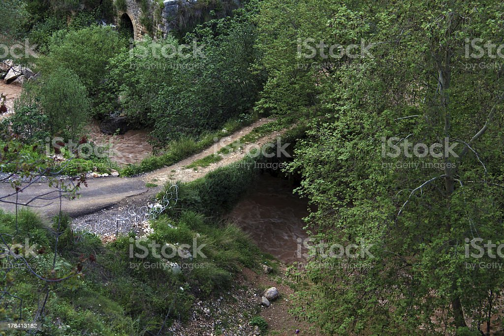 Bridge over Murky River stock photo