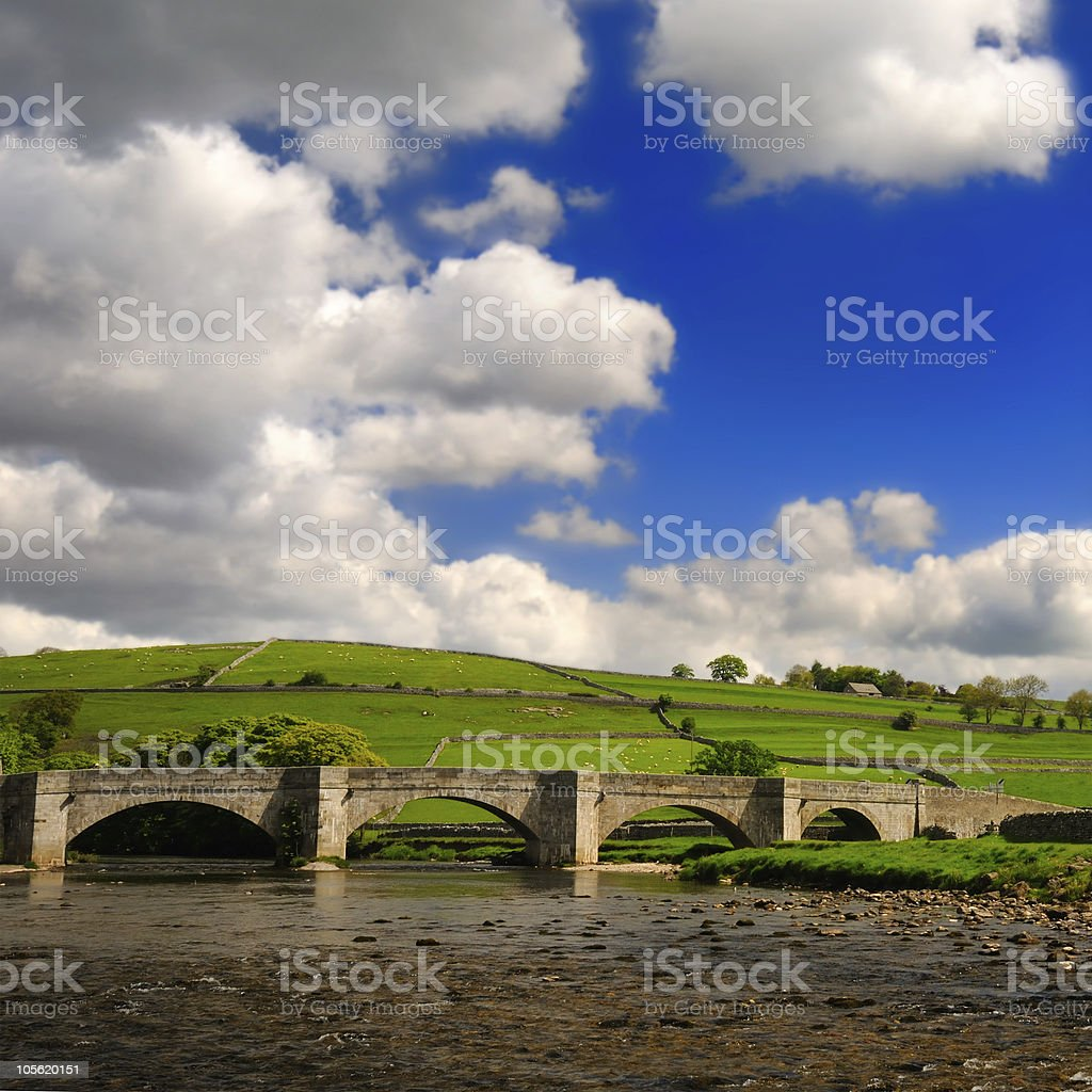 Bridge over peaceful Wharfe river in Yorkshire Dales National Pa royalty-free stock photo
