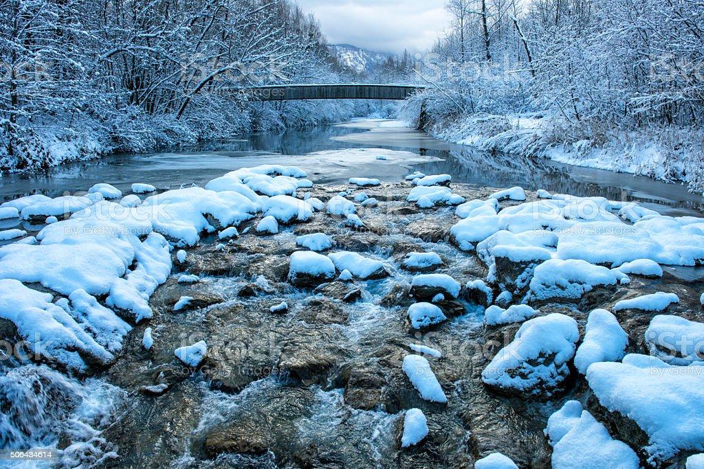bridge over river at winter morning stock photo
