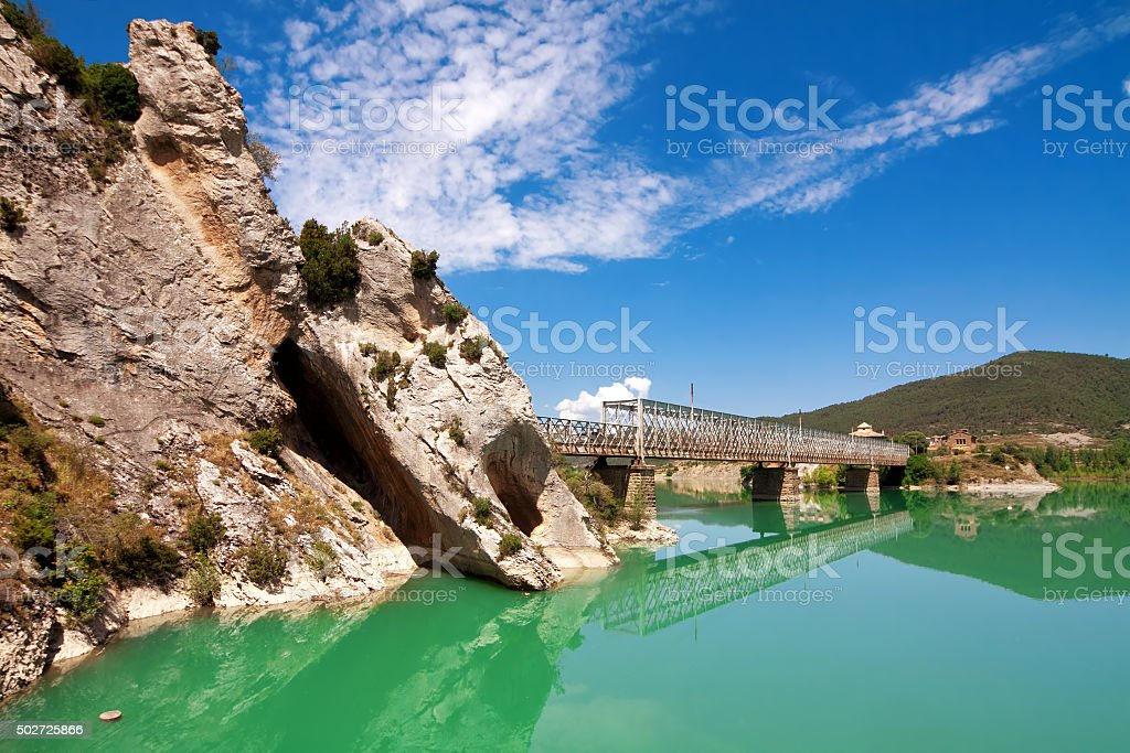 Bridge over River Gallego, province Aragon, Spain.Reservoir Rena stock photo
