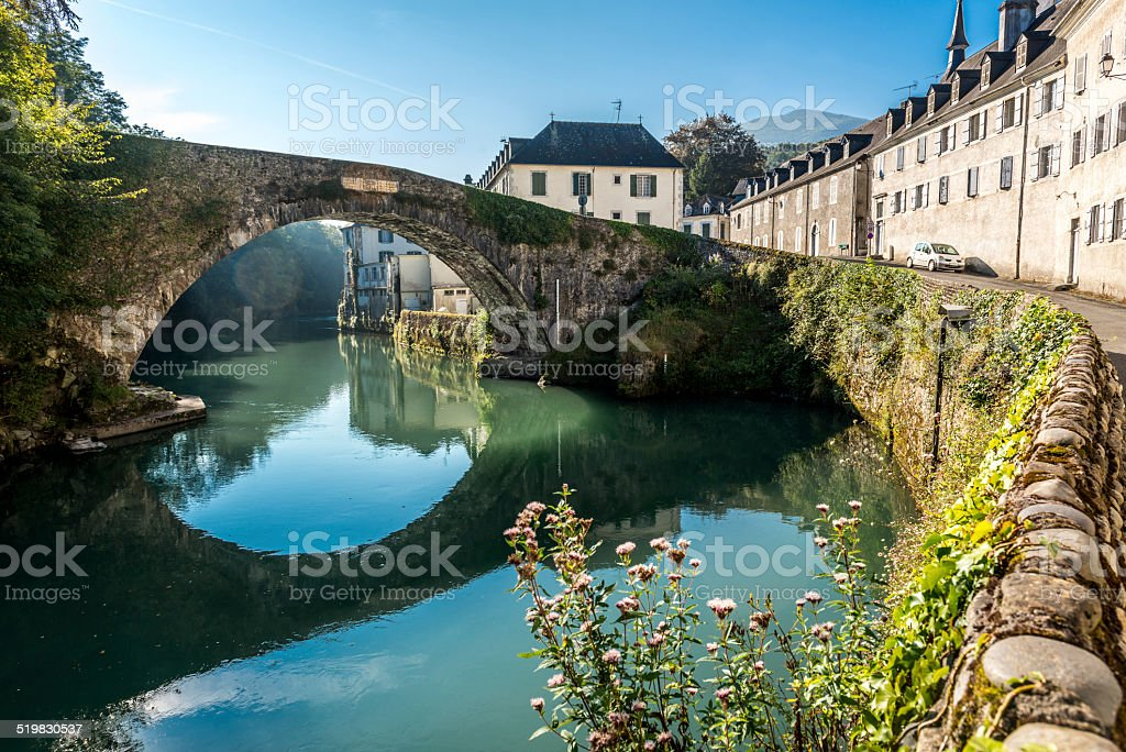 Bridge over river Le Gave stock photo