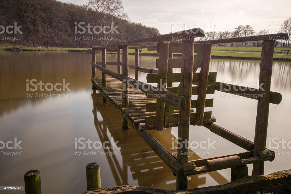 bridge over smooth water stock photo