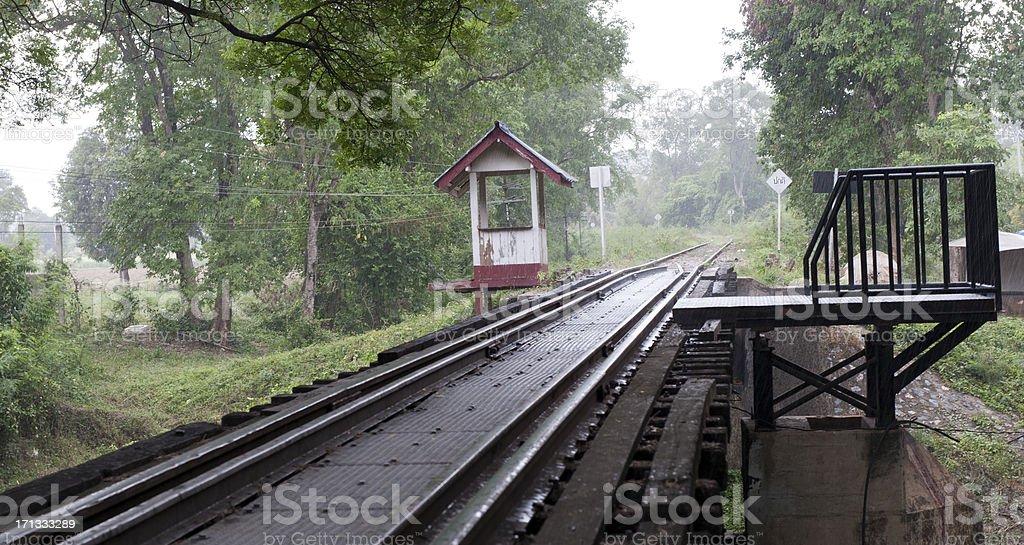 bridge over the river Kwai in pouring rain stock photo