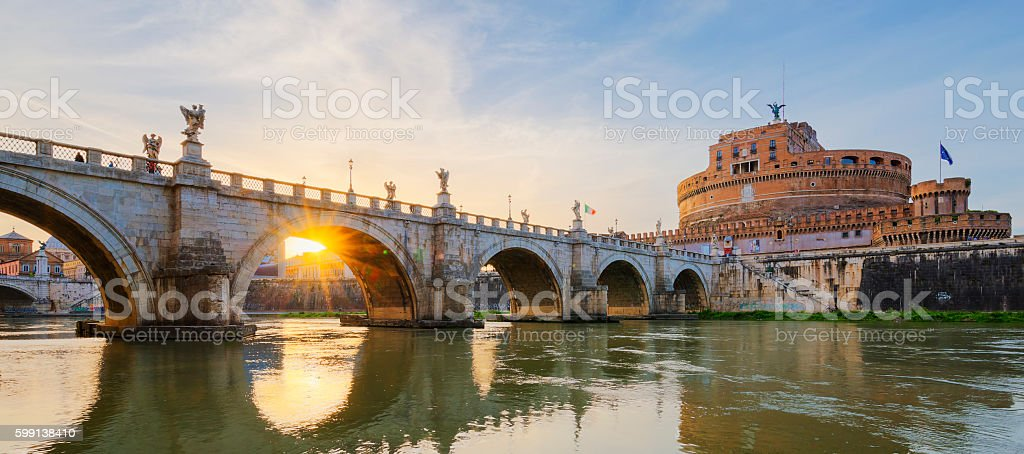 Bridge over the Tiber River in Rome at sunset. stock photo