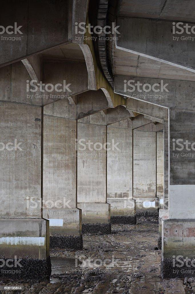 Bridge pillars at low tide stock photo